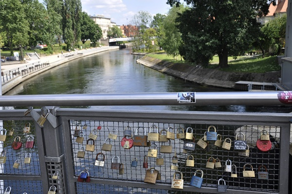 There's a fence in Bydgoszcz, a town in Poland where couples come, put on an engraved lock and throw the key out into the river. There are usually names and dates on.  A perfect way to say I love you...