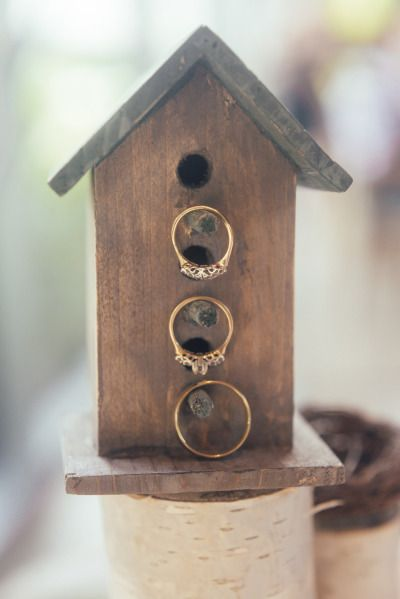 How lovely! ... bird house centrepieces for the tables too...