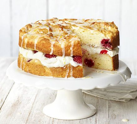 Lemon curd yogurt gives this gluten-free sponge cake a lovely light texture. It's filled with cream and berries and topped with a drizzle icing