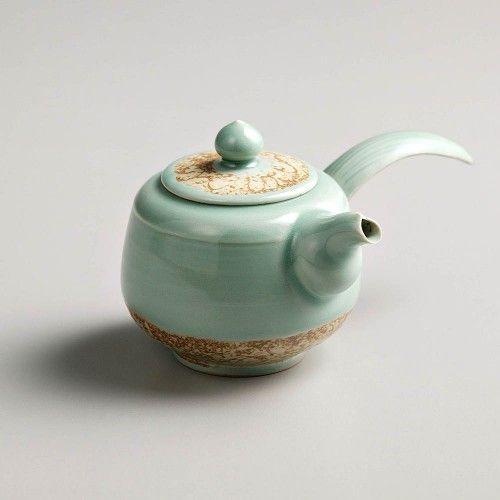 Celadon crocketed ceramic pot with long handle Seung-pyo,Lee @ https://www.gokoco.com/gkc/home-accessories-decoration/artisan-handmade-celadon-crocketed-ceramic-pot-with-long-handle-seung-pyo-lee.html #handmadeartisans #ceramicpotwithlonghandle #homeaccessories #homemaceramicpot