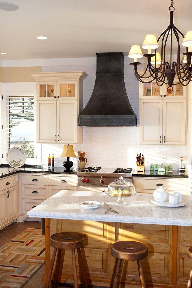 wolf rangetop Kitchen Traditional with black countertop black range hood chandelier cooktop