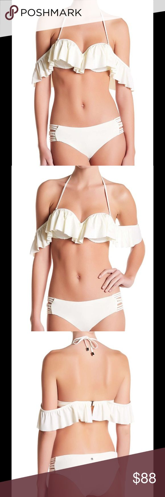 Raisins Bikini Top and bottom cream M Cream bikini Maldives top and bottom NEw with tags! Brief cut bottoms with cutout sides and details at sides with crochet trim fully lined and a cheeky coverage plus fits true to size. Mix and match top and bottom sizes bottoms come in size S, M, L and top in S, M, L retails for $129 for top and bottom. Will sell top or bottom separately also comes in teal/ blue. Raisins Swim Bikinis