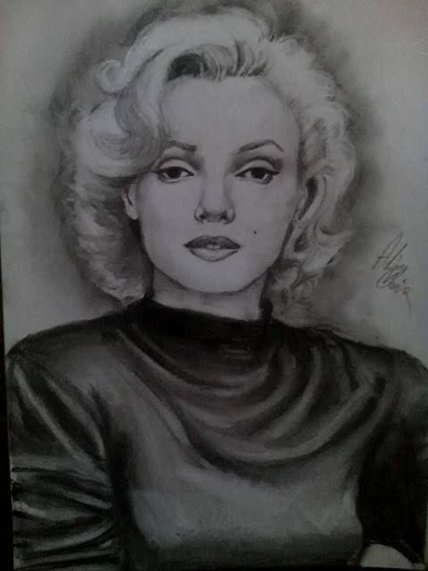 Here is my Marilyn monroe drawing charcoal on A4