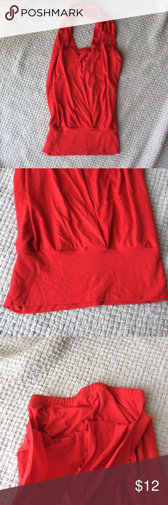 """Stretchy red halter A stretchy knit jersey material gives a nice drape to your silhouette in a true red color (hello sexy black shoes!). The body is a tube top, and then the halter slips over your head. Size xs, tube top portion is 18"""" long Bisou Bisou Tops Blouses"""