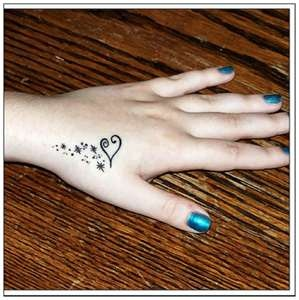 hand heart tattoo