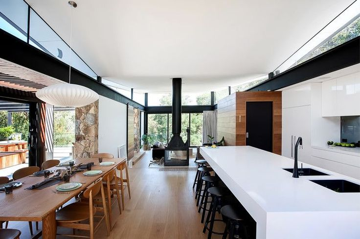 Warrandyte House by Alexandra Buchanan Architecture, photo by Marvelle Photography Fireplace Radiante 846 2V double sided cast iron French fireplace