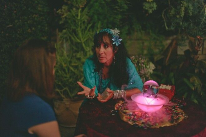 Add a fun mystic touch to your wedding reception with a fortune teller (but only positive feedback for your guests)