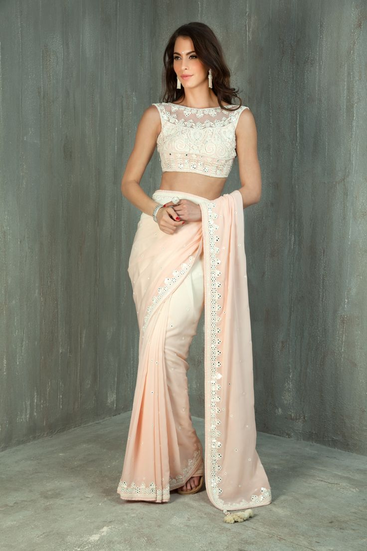 Shaded georgette saree with net blouse embellished with resham, mirror and sequins work
