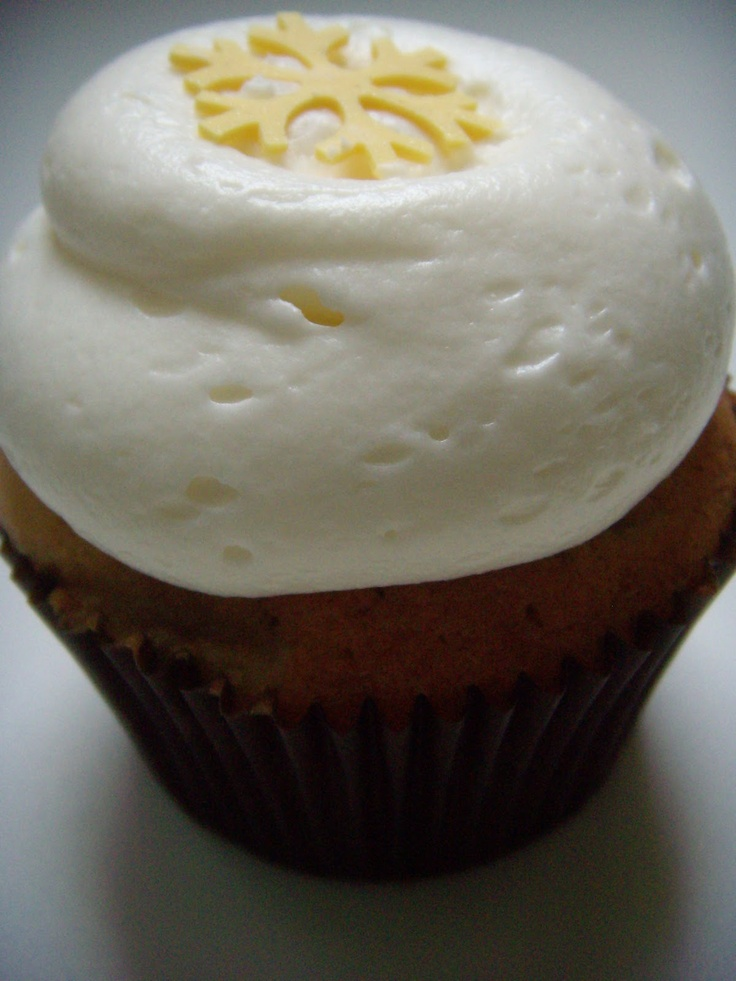 banana cupcake topped with a vanilla cream cheese frosting