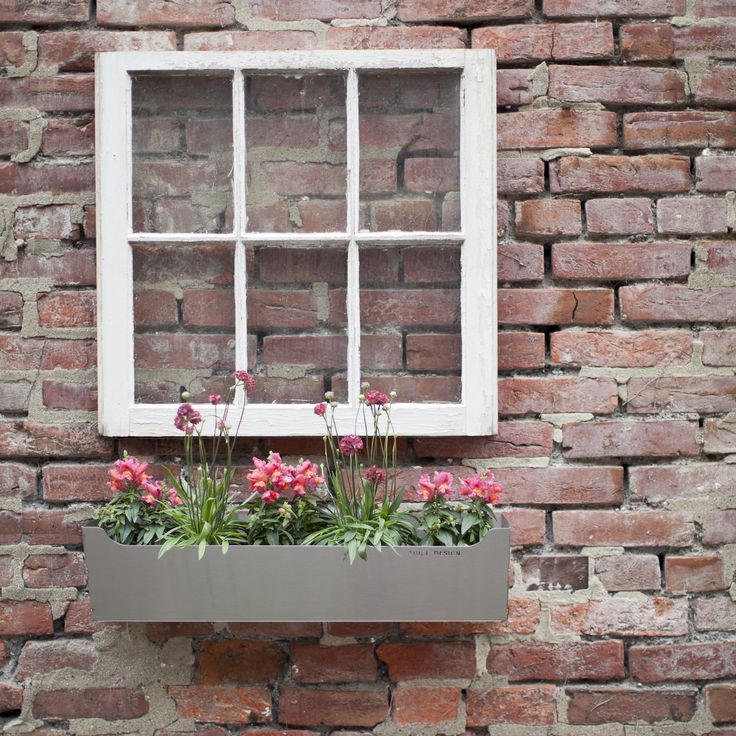 Edgley window garden box love this concept!  Mount a traditional framed window with a box under for a freestanding window box effect on a brick wall.