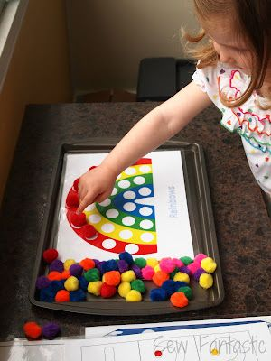 Printable pompom craft sheets, coloful pompoms and magnets make for a great rainy day activity