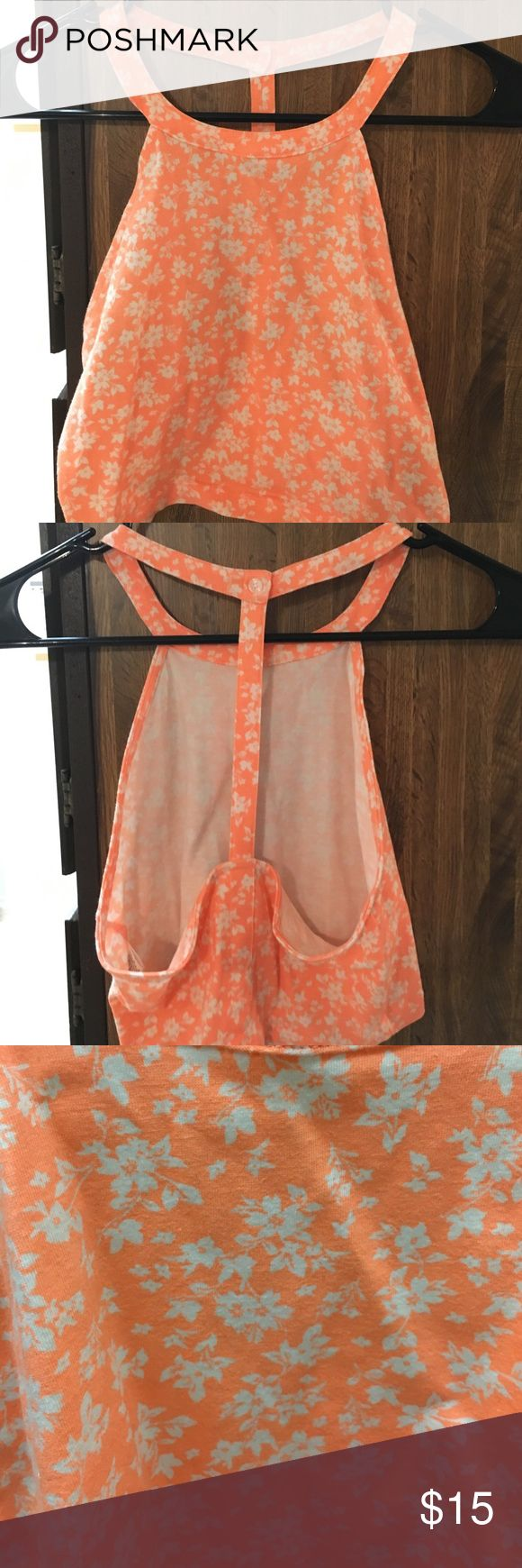 Bright neon top floral top Hard to tell in the photo but it is a bright neon pinky orange Charlotte Russe Tops Tank Tops