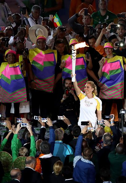 #RIO2016 Former basketball player Hortencia Marcari carries the Olympic torch during the Opening Ceremony of the Rio 2016 Olympic Games at Maracana Stadium on...