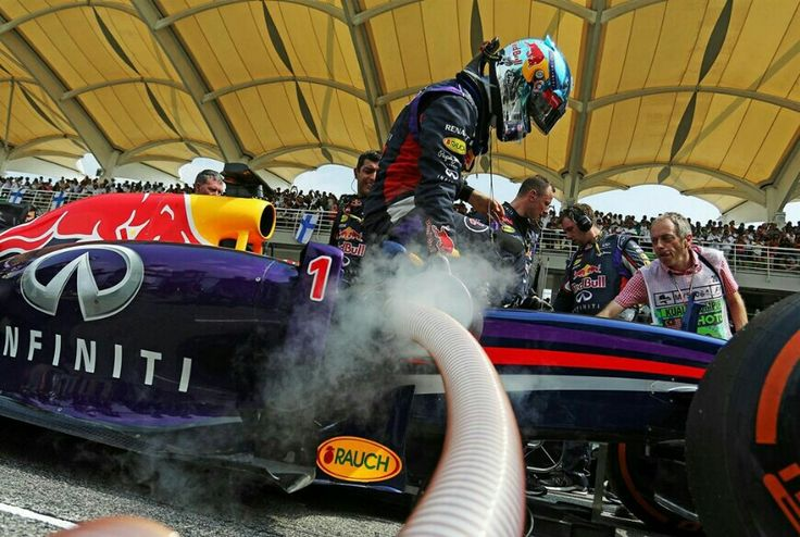 Sebastian Vettel getting in F1 car