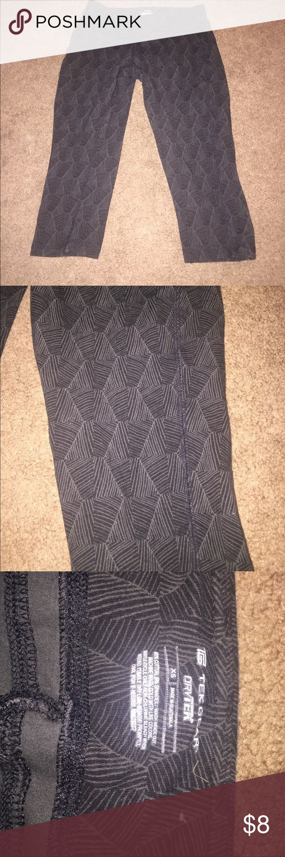 Tek gear dry tek workout Capri This is a pair of xs workout capris they are black with gray designs they are used. tek gear Pants Capris