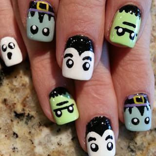 A few Frankenstein's monsters and Draculas.   27 Delightfully Spooky Ideas For Halloween Nail Art