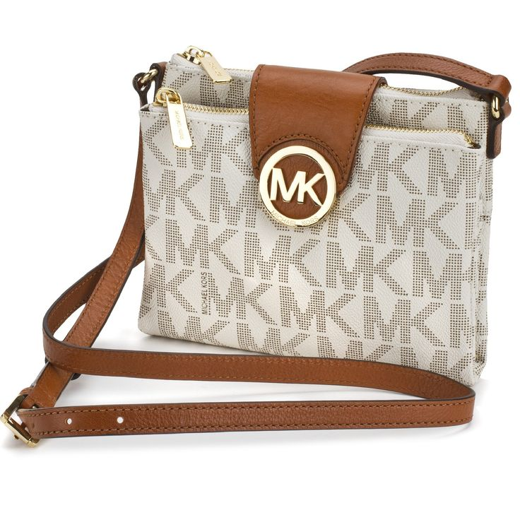 A trendy yet polished monogram print adorns this sleek Michael Michael Kors crossbody bag. Features a pebbled PVC exterior, dual top zip closures with magnetic logo charm closure, one outer pocket and a buckle-adjustable crossbody strap.