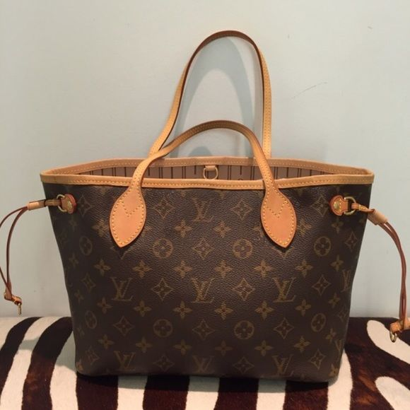 Louis Vuitton Neverfull PM 100% Authentic. Used once. 11.4 x 8.7 x 5.1 inches. Redesigned interior with Louis Vuitton archive details. Textile lined inside pocket with matching interior. Natural cowhide leather trim. Poshmark offers free authentication, this was a gift. Date code: SD3140 includes everything that came in the box. Louis Vuitton Bags Totes