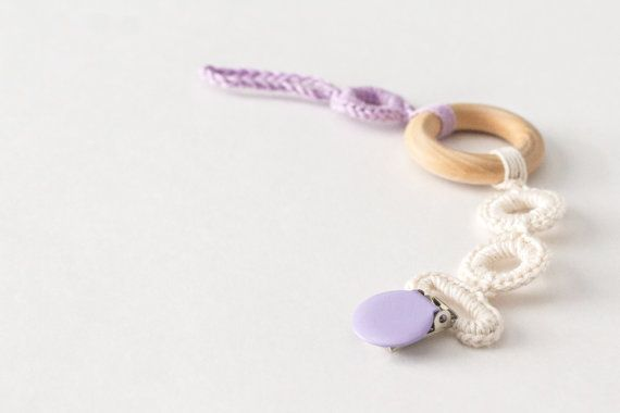 Teething pacifier clip with organic natural teething ring in pretty lilac and white. #teething #pacifierclip #sootherclip #crochet #modernbaby #babygirl