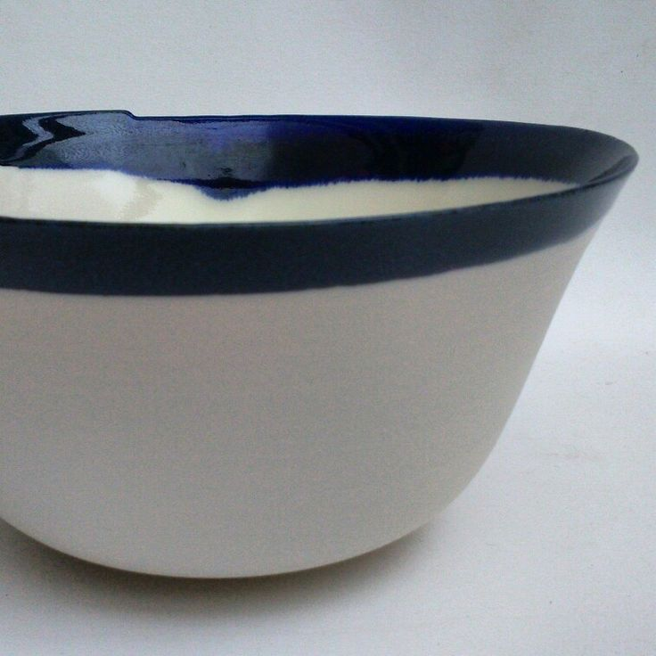 Wheel-thrown porcelain bowl w asymmetric rim