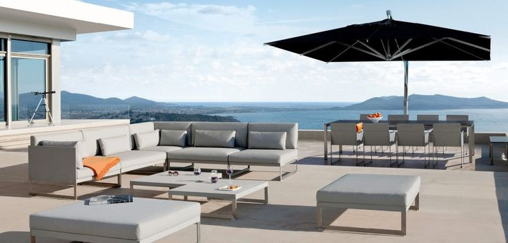 Hanging umbrella by MANUTTI - exclusive Belgian outdoor furniture - Enjoying a light breeze in the shade on a sun-baked day is glorious. Manutti offers both traditional parasols and a suspended version available in different sizes. Quality and technology combined in a choice of different finishes: hardwood, teak, aluminum or teak and aluminum combined.