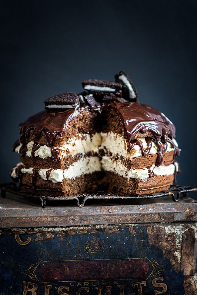 Cookies and Cream layer cake with white chocolate filling, rich chocolate glaze and crushed Oreo cookies | Supergolden Bakes