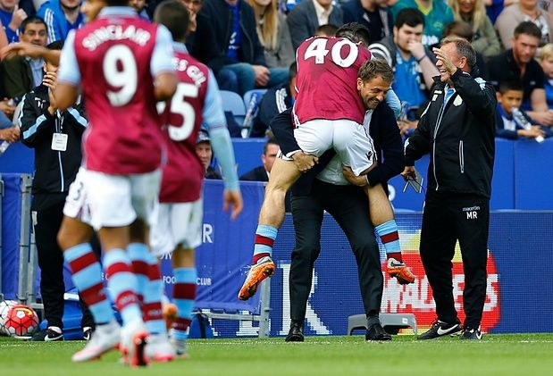 A delighted Jack Grealish immediately runs to Aston Villa manager Tim Sherwood and assistant coach Mark Robson after scoring his first ever Villa Park goal against Leicester City.