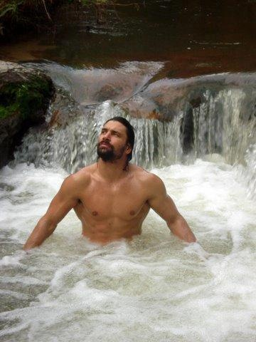 Manu Bennett as Zeke Hayes--in a waterfall. Dear God. I'm going to go have a heart attack now. In all the right ways.