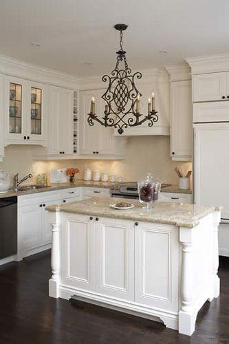 white cabinets, dark floors