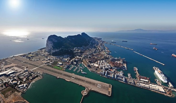 The spectacular scene that is the Rock of Gibraltar abutted by the airport runway jutting out into the sea. Because of geopolitical tensions between Britain, which controls Gibraltar, and Spain, road travel into adjoining Spain is very cumbersome, rendering the airport very important.