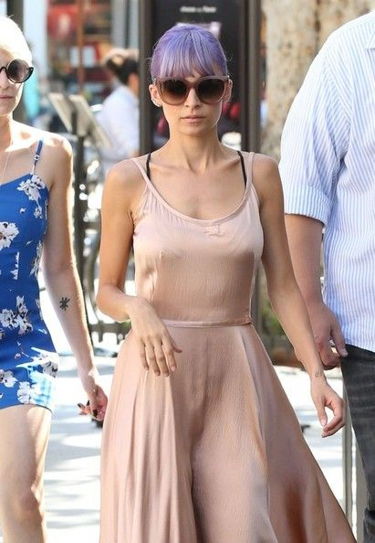 Socialite Nicole Richie picks up some coffee while taking a break from filming at The Grove in Los Angeles, California on June 20, 2014. Nicole and her rocker husband Joel Madden recently sold their gorgeous Glendale, CA home for $1.8 million!