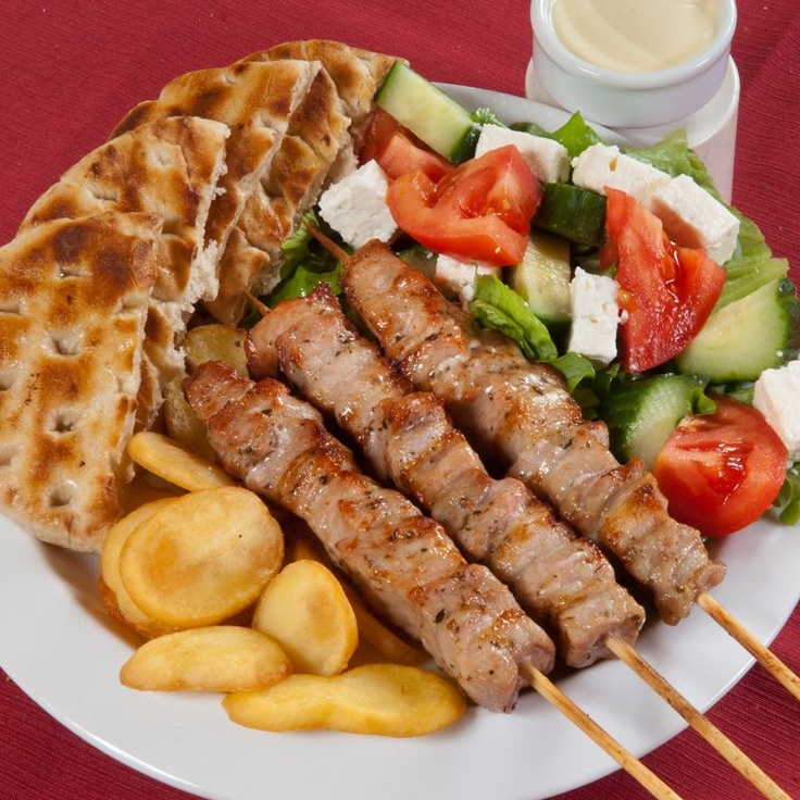 Typical greek meal of souvlaki pita fries and a salad this meal is usually eaten for dinner - Healthy greek recipes for dinner mediterranean savour ...