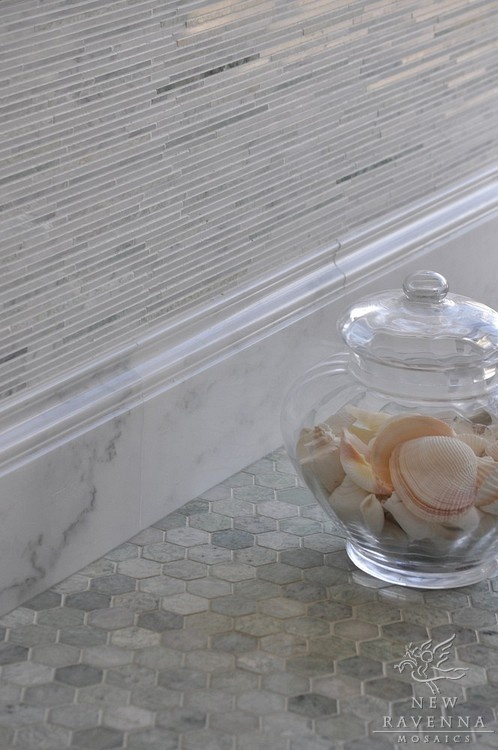 Gorgeous, wall tile, marble baseboards and hexagons on floor.