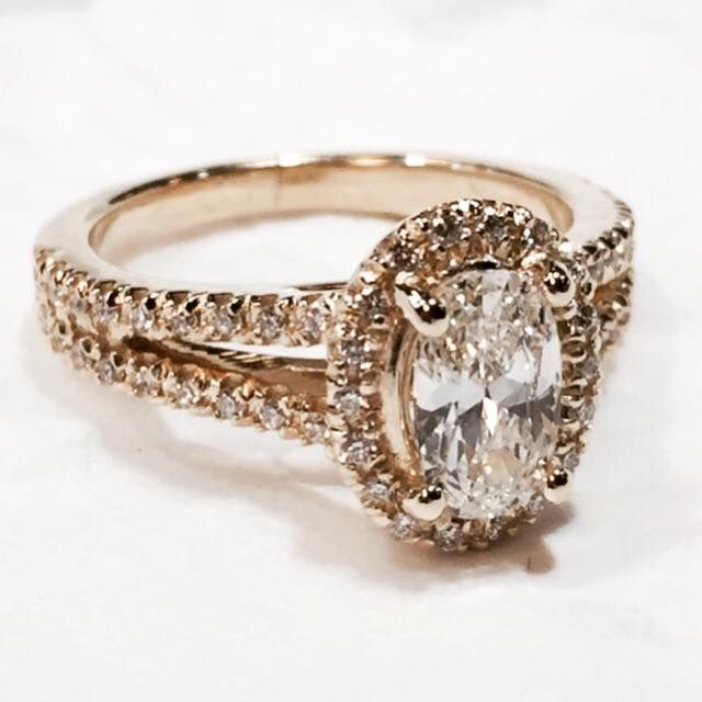 My Engagement Ring! Oval halo with 3/4 ct. center diamond. Yellow gold with split shank. Made by Tresor Jewelers