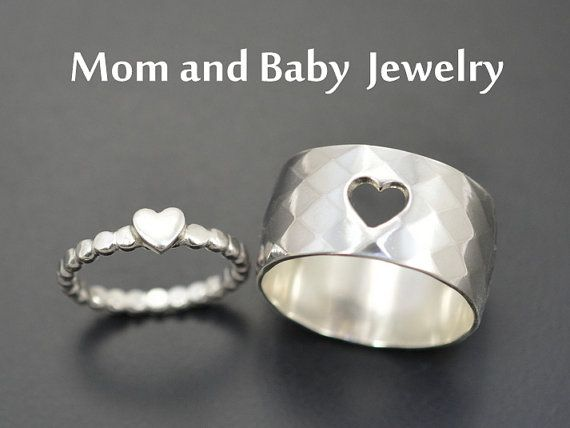 This gorgeous set of Mother and Daughter rings are crafted out of 925 Sterling silver band. One heart is cut out of the large, thick, sterling silver wide band and used for another ring. 💕 100% Handmade 💕 The two rings fit into one another, symbolizing togetherness. Perfect for a baby