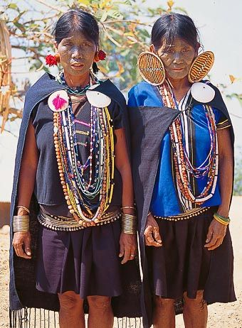Burma/Myanmar   Large ear plugs and tattooed faces   ©AllMyanmar