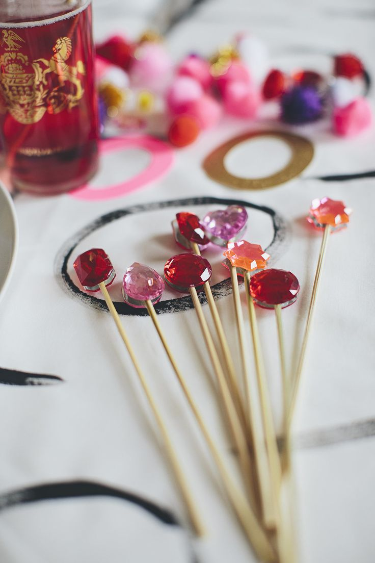Making these DIY drink stirrers is a cinch! Just glue plastic gems back to back on dowels.