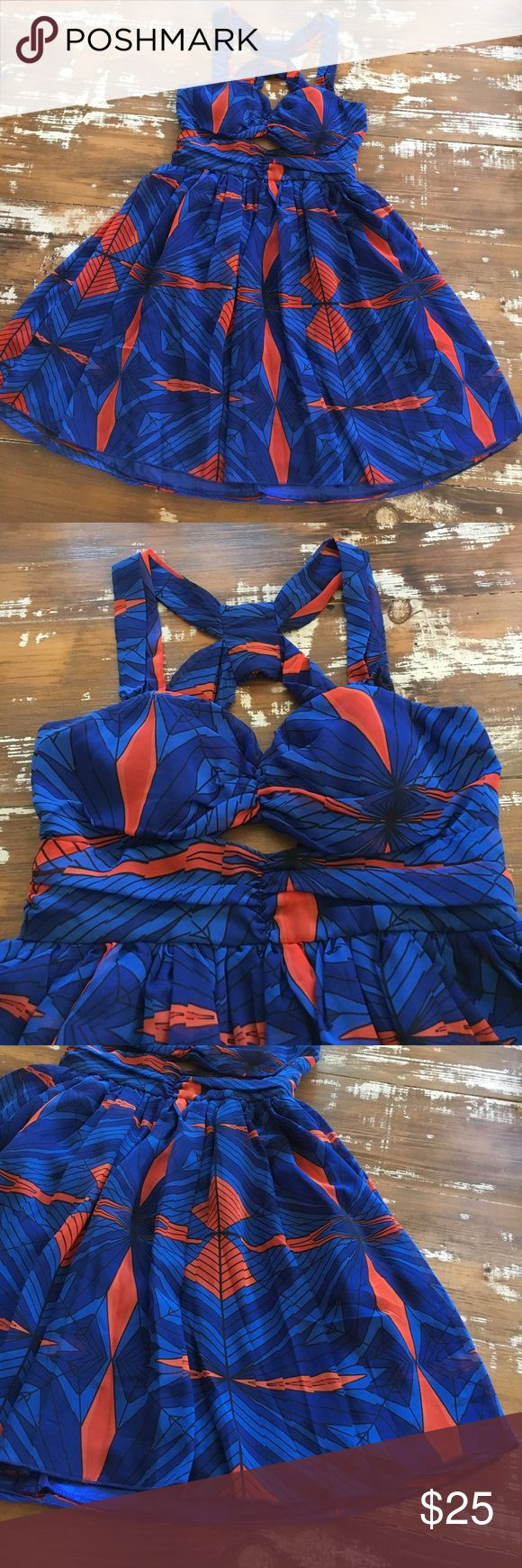 💙✴️BLUE|ORANGE Print Skater Dress! ✴️How adorable is this dress?!??? Super cute short skater type dress, zips in back to waist. Cross cross back design, lightly padded with sweetheart neckline and cut out! Fully lined too! Designed with Bright shades of cobalt and light blue mixed with deep orange. Worn once and sadly doesn't fit anymore. Excellent brand new condition!✴️ OFFERS WELCOME! 😙 XOXO Dresses Mini