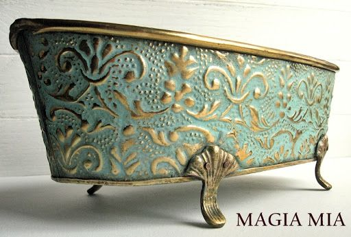 DIY: How to Paint Brass - tutorial shows how an inexpensive piece of brass was painted with homemade chalk paint, then wiped with a rag to reveal the details. She also explains how she makes chalk paint, using craft paint - Magia Mia