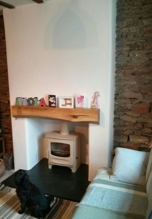 Charnwood C5 Woodburning stove.  The dog loves the new look, what a change from the original natty stone clad fireplace.