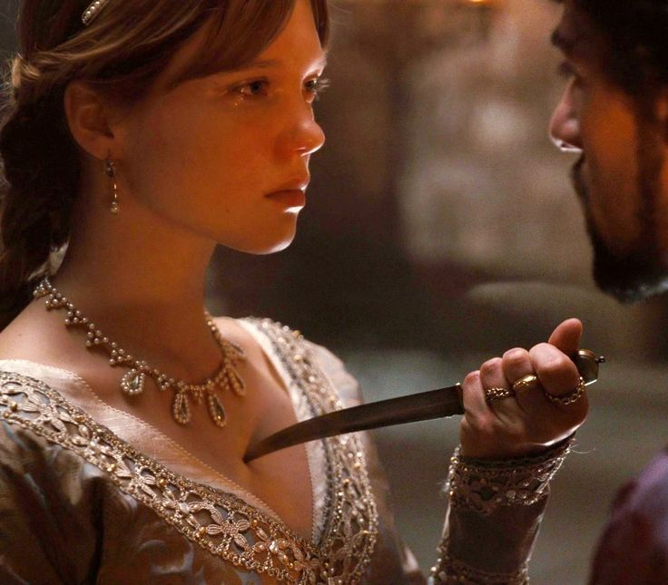 """""""This is what you want, isn't it? For me to die?"""" His silver eyes remained on me, never giving the blade a second glance. """"I should,"""" whispered Corvin. """"But I don't."""""""