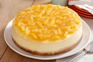 Pineapple-Topped New York Cheesecake recipe  7   HONEY MAID Honey Grahams, finely crushed (about 1 cup)  3  Tbsp.  butter, melted  1  cup  plus 3 Tbsp. sugar, divided  4  pkg.  (8 oz. each) PHILADELPHIA Cream Cheese, softened  1  cup  BREAKSTONE'S or KNUDSEN Sour Cream  1  Tbsp.  vanilla  4   eggs  1  can  (8 oz.) pineapple tidbits in juice, very well drained  1/2  cup  pineapple preserves