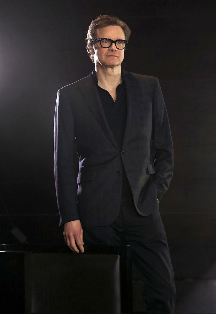 Colin Firth in a suit ...