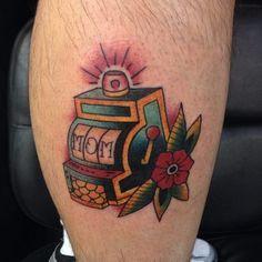 Casino machine tattoo