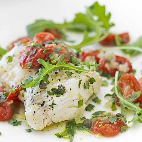 Fish parcels with tomatoes and capers