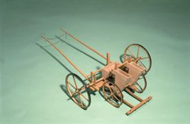 Model, scale 1:4, of Jethro Tull's seed drill, c. 1701. Tull's seed drill of circa 1701 represented a major step towards the mechanisation of crop cultivation. The machine would be drawn by a horse and sowed three regularly spaced rows of wheat grains. This regular spacing, as opposed to broadcast sowing of seeds, made possible the introduction, also by Tull, of a horse-drawn hoe to remove weeds growing amongst the crop.