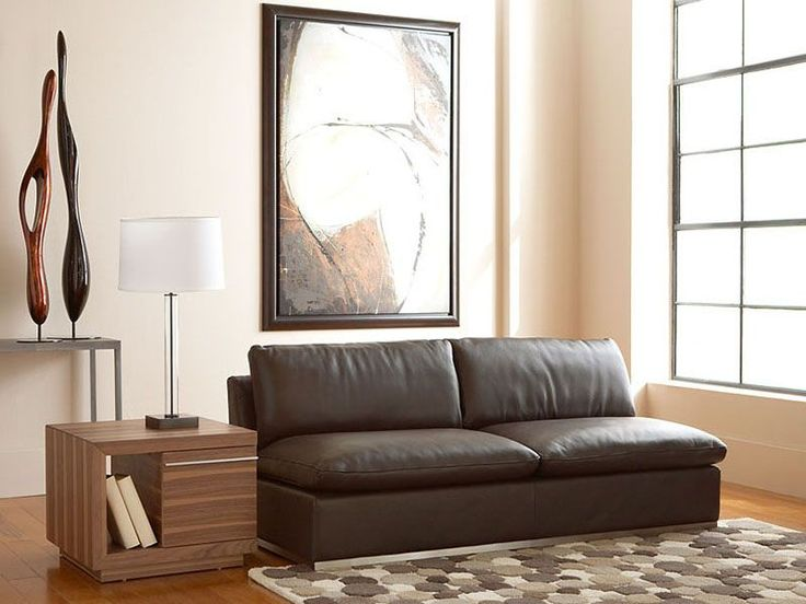 For students short on apartment living room space -- avoid overstuffed sofas and go for something armless and sleek to save space and make the room look larger. | Amani Armless Loveseat cort.comLiving Room