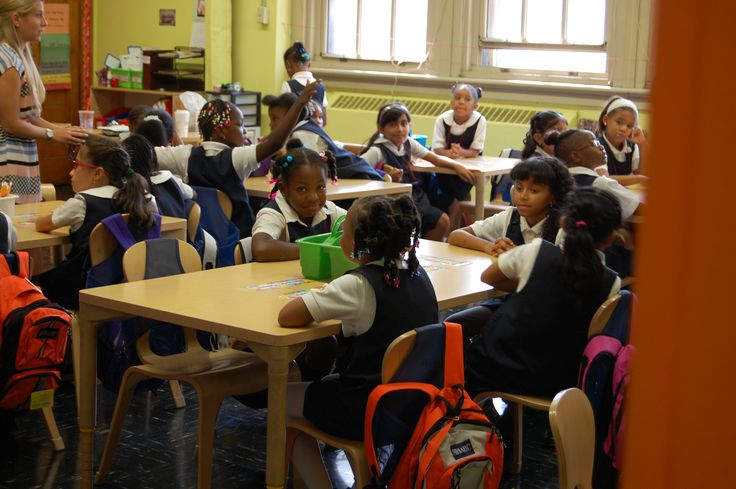 Girls Prep Bronx scholars on the first day of school with brand new donated backpacks on their seats.