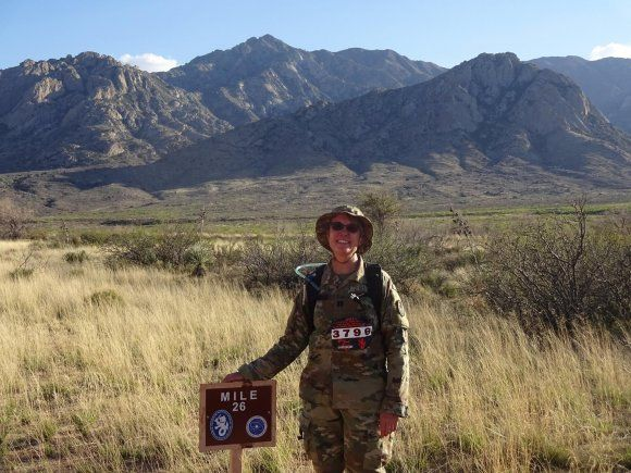 Capt. Lacey Dean, U.S. Army Space and Missile Defense Command/Army Forces Strategic Command, poses for a photo at mile 26 of the 28th Bataan Memorial Death March at White Sands Missile Range March 19.