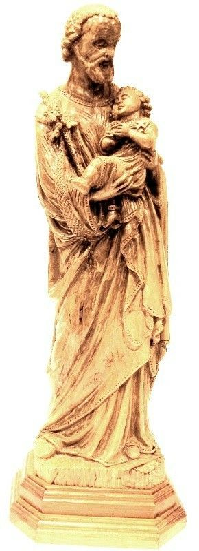 """Large St. Joseph Statue (36"""" Tall)  Color/Quantity: Brown - Very Large Material: Olive Wood Price: $7,849.00  (Brown - Very Large) $7,849.00 SOLD OUT - however, you may ask to have one carved.  This awesome large wooden statue of St. Joseph is hand carved from a large block of beautiful Holy Land olive wood in the Nissan Brothers workshop in Bethlehem. The breathtaking statue of St. Joseph holding Baby Jesus stands 3 feet tall and is life like in detail."""
